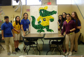 students with artwork of Gator